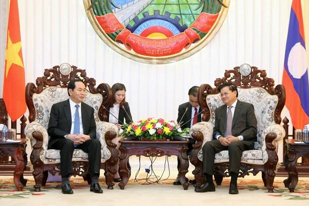 越南国家主席陈大光分别会见老挝总理与老挝国会主席 hinh anh 1