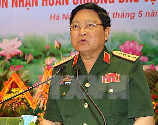 越南防长吴春历:国防力量需严格贯实行党关于军事与国防任务的决议 hinh anh 1