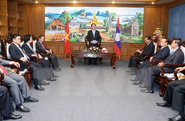 越南国家主席陈大光访问老挝占巴塞省 hinh anh 1