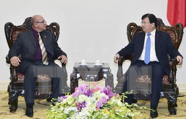 越南政府副总理郑庭勇会见古巴建设部部长雷内·梅萨 hinh anh 1