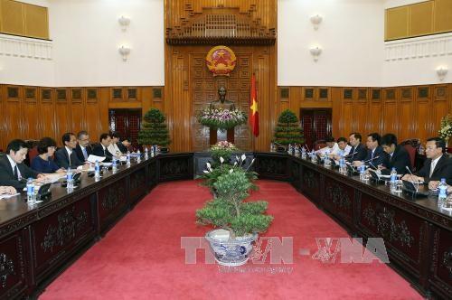 越南政府副总理王廷惠会见日本国际协力机构副主席富吉健一 hinh anh 1