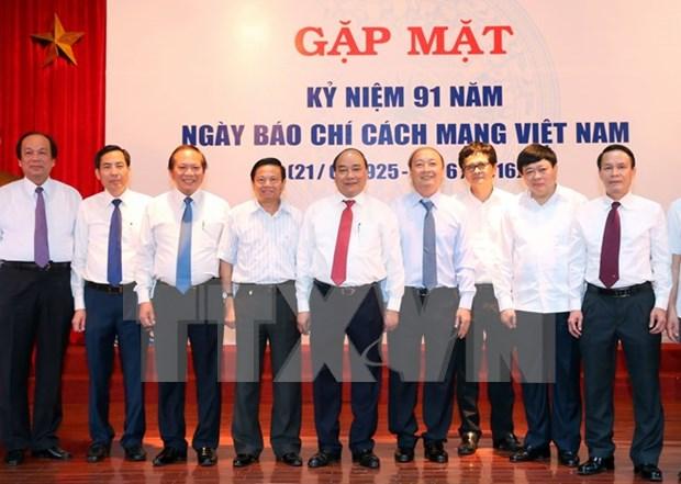 阮春福总理:新闻媒体机构应不断更新活动方式以更好地满足民众需求 hinh anh 1