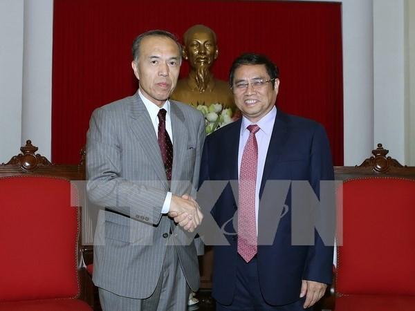 越共中央组织部部长范明正会见日本高级专家代表团 hinh anh 1
