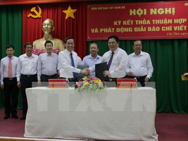 越南西南部指委会同越南新闻工作者协会加强信息合作 hinh anh 1