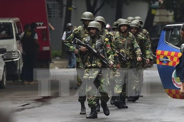 越外交部发言人:目前未收到越南公民在孟加拉国恐怖袭击事件中伤亡的报告 hinh anh 1