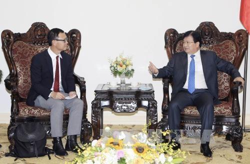 越南政府副总理郑廷勇会见泰国暹罗水泥集团领导 hinh anh 1