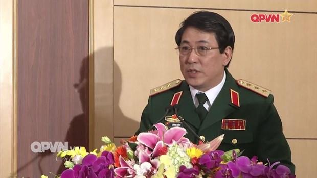 越南人民军高级政治干部代表团对老挝进行正式友好访问 hinh anh 1