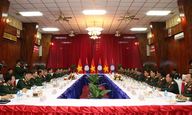 老挝领导人高度评价越老两国军队的合作结果 hinh anh 2