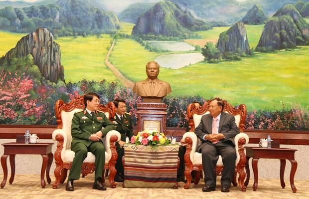 老挝领导人高度评价越老两国军队的合作结果 hinh anh 1