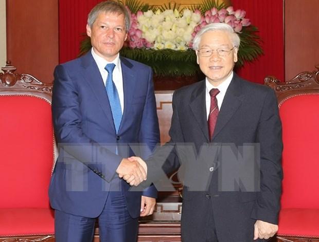 越共中央总书记阮富仲会见罗马尼亚总理达契安•乔洛什 hinh anh 1