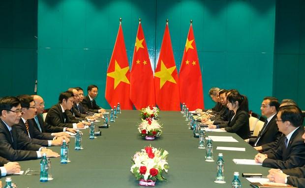 越南政府总理阮春福会见中国总理和保加利亚总统 hinh anh 2