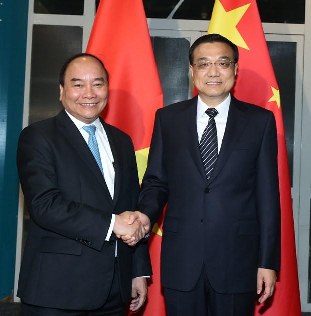 越南政府总理阮春福会见中国总理和保加利亚总统 hinh anh 1