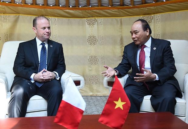 越南政府总理阮春福会见出席第十一届亚欧首脑会议的各国领导人 hinh anh 6