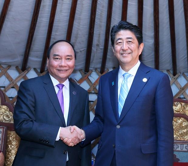越南政府总理阮春福会见出席第十一届亚欧首脑会议的各国领导人 hinh anh 9