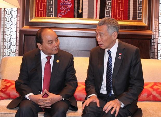 越南政府总理阮春福会见出席第十一届亚欧首脑会议的各国领导人 hinh anh 3