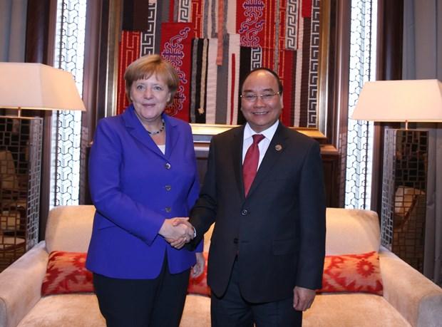 越南政府总理阮春福会见出席第十一届亚欧首脑会议的各国领导人 hinh anh 5