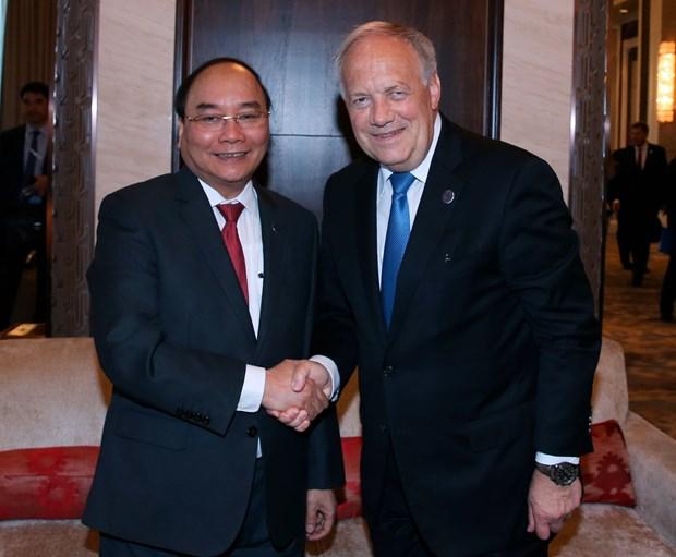 越南政府总理阮春福会见出席第十一届亚欧首脑会议的各国领导人 hinh anh 2