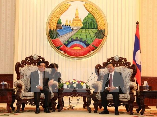老挝领导人高度评价越老良好的合作关系 hinh anh 2