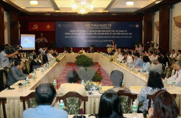 关于海牙仲裁法庭所做出的裁决相关法律问题的国际研讨会在胡志明市举行 hinh anh 1