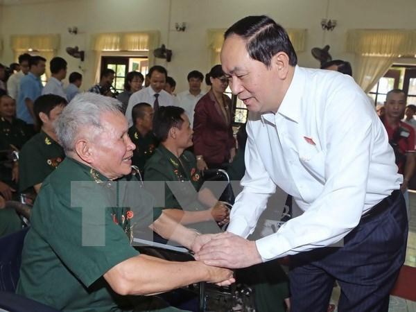 越南伤残军人与烈士日69周年:陈大光主席走访慰问河南省伤残军人 hinh anh 1