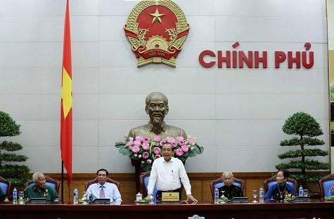 越南政府副总理张和平会见金瓯省革命有功者代表团 hinh anh 1