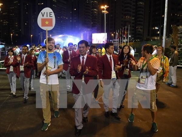 越南体育代表团举行2016年奥运会升旗仪式 hinh anh 1