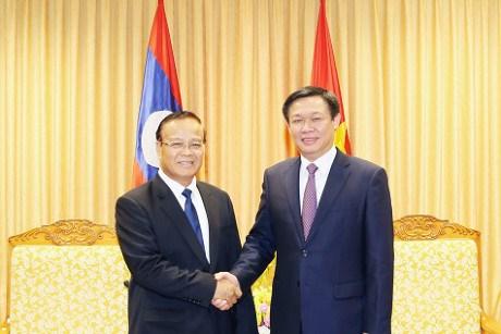王廷惠副总理会见老挝财政部长宋迪·隆迪 hinh anh 1