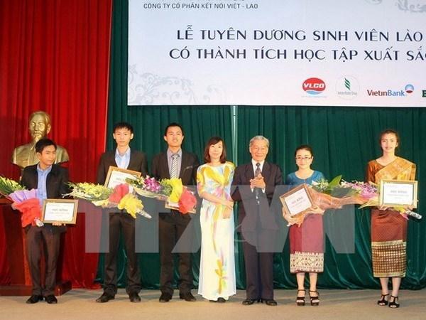 越南承天顺化省与老挝占巴塞省加强教育培训领域的合作 hinh anh 1