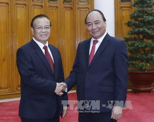 越南政府总理阮春福会见老挝副总理兼财政部长宋迪·隆迪 hinh anh 1