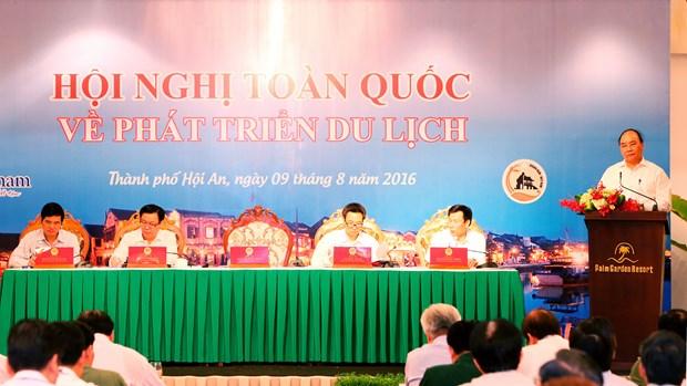 阮春福总理出席越南全国旅游发展会议 hinh anh 1