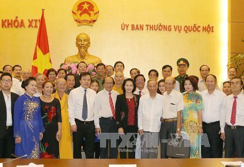 越南国会主席阮氏金银:越南党和国家一直关注民族文化保护与传承工作 hinh anh 1