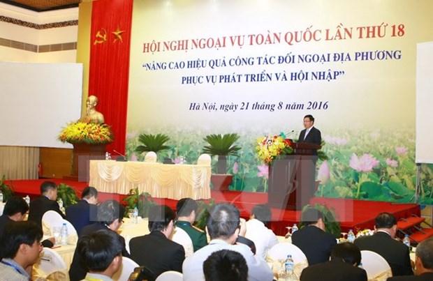越南第18届全国外事工作会议:提高地方对外工作服务于发展与融入国际社会 hinh anh 1
