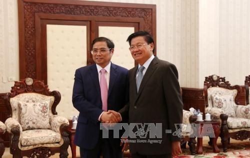 老挝人革党中央总书记、国家主席本扬•沃拉吉会见越共组织部高级代表团 hinh anh 2
