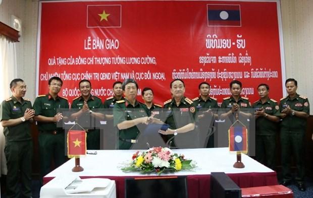 越南协助老挝人民军各主力师团实现现代化 hinh anh 1