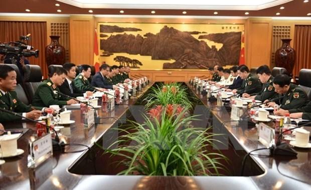 越南军事高级代表团对中国进行正式友好访问 hinh anh 1