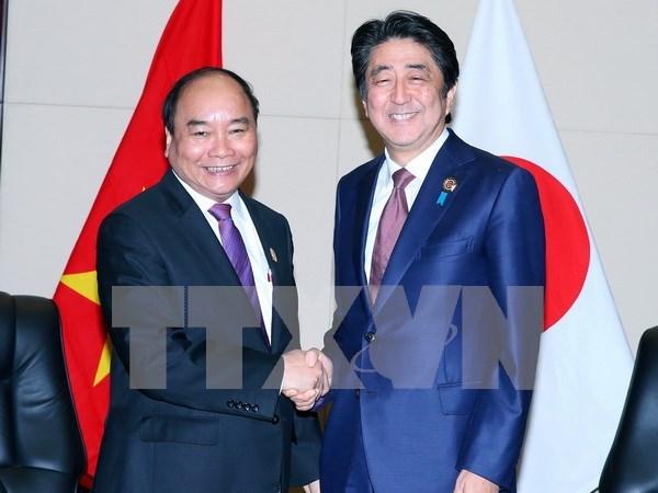 阮春福总理会见日本首相安倍晋三及新西兰总理约翰•基 hinh anh 1