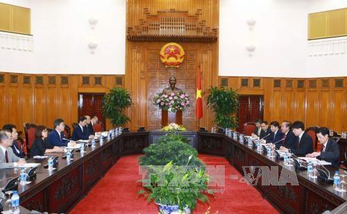 越南政府常务副总理张和平会见爱知县知事 hinh anh 1