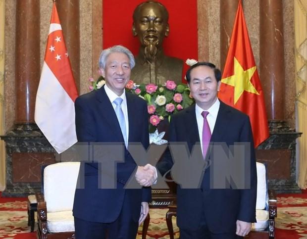 越南国家主席陈大光会见新加坡副总理张志贤 hinh anh 1