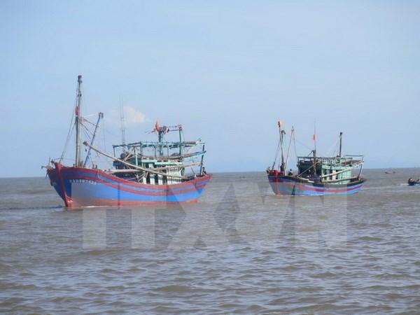 在海上遇险并得到中国及时救助的四名越南渔民已回国 hinh anh 1