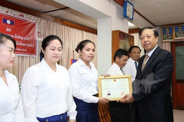 老挝公安部开设新一届越语培训班 hinh anh 1