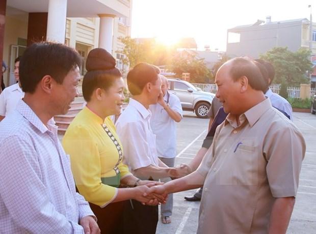 阮春福总理主持山罗水电站移民安置项目实施15周年总结会议 hinh anh 1