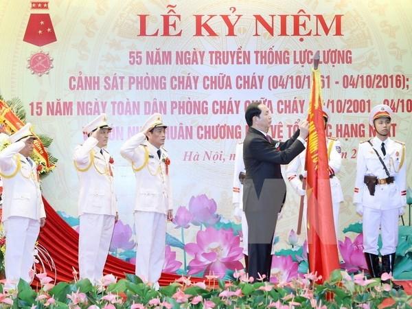国家主席陈大光出席消防警察力量传统日55周年纪念典礼 hinh anh 1