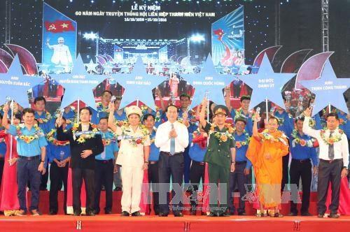 越南国家主席陈大光出席越南青年联合会成立60周年纪念典礼 hinh anh 1
