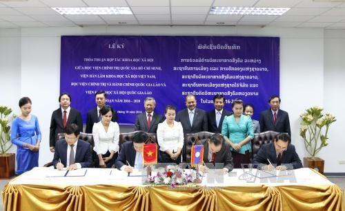 越南和老挝加强科学领域的合作 hinh anh 1