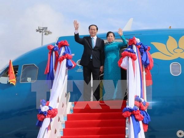越南国家主席陈大光与夫人即将对古巴进行正式访问并出席APEC会议 hinh anh 1