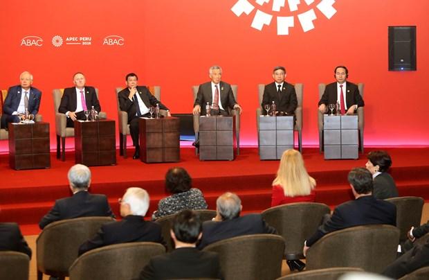 越南国家主席陈大光出席2016年亚太经合组织领导人会议周 hinh anh 2