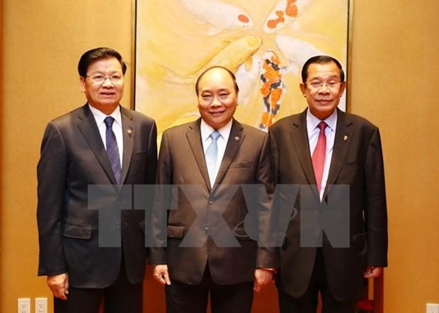 政府总理阮春福出席第31届东盟峰会系列活动 (组图) hinh anh 9