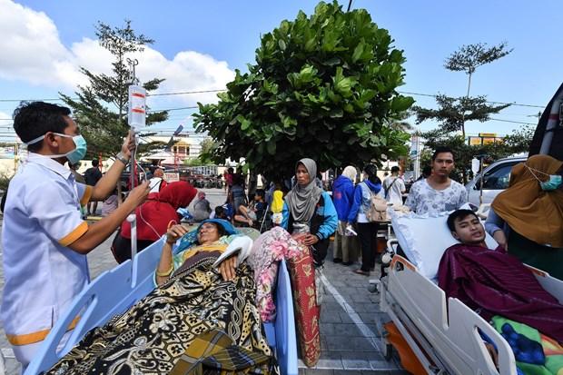 印尼西努沙登加拉省龙目岛地震后的惨状(组图) hinh anh 13