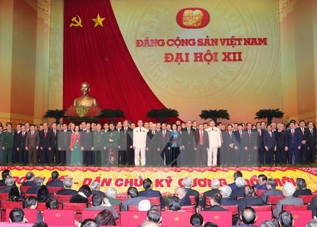 越共十二大:老挝友人和旅老越南人社群喜庆越共十二大成功召开 hinh anh 1