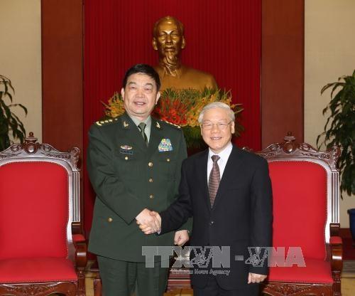 越共中央总书记阮富仲会见中国国防部高级代表团 hinh anh 1